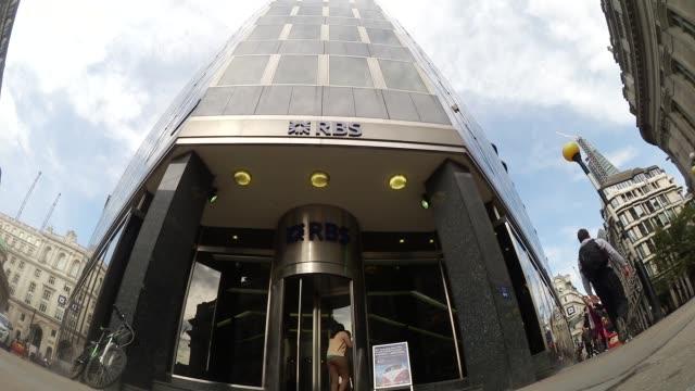 vídeos de stock, filmes e b-roll de various shots pedestrians walk past a branch of royal bank of scotland group plc in london uk on friday sept 27 2013 rbs says corsair in exclusive... - exclusivo