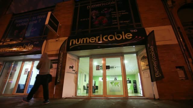 various shots pedestrians walk past a numericable sas store operated by the french cabletv provider in toulouse france on tuesday oct 29 2013... - cable tv stock videos & royalty-free footage