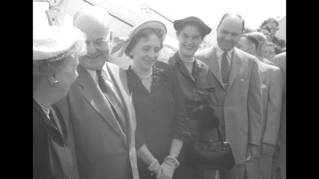 various shots photographers among people gathered for maiden voyage of the ss united states / photographers and cameramen pan to first lady bess... - margaret truman stock-videos und b-roll-filmmaterial