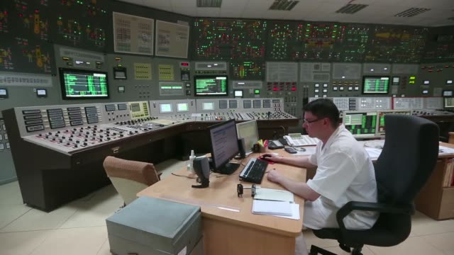 Various shots plant engineers monitor information screens in the control room at the Dukovany nuclear power plant operated by CEZ AS in Dukovany...