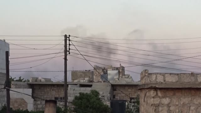 various shots seen from both aleppo and idlib show that flames and smoke rise after russian forces allegedly use cluster and phosphorus bombs on... - 空爆点の映像素材/bロール