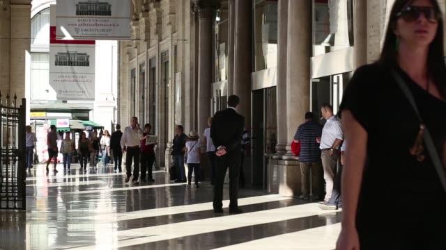 vídeos de stock, filmes e b-roll de various shots shoppers walk through a covered arcade at the galleria alberto sordi shopping mall in rome italy on monday oct 20 general views... - produto interno bruto