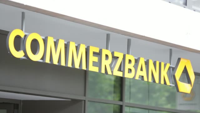 various shots signage with logo hangs outside a branch of commerzbank ag in frankfurt germany on friday june 20 various shots pedestrians walk past... - ヘッセン州点の映像素材/bロール