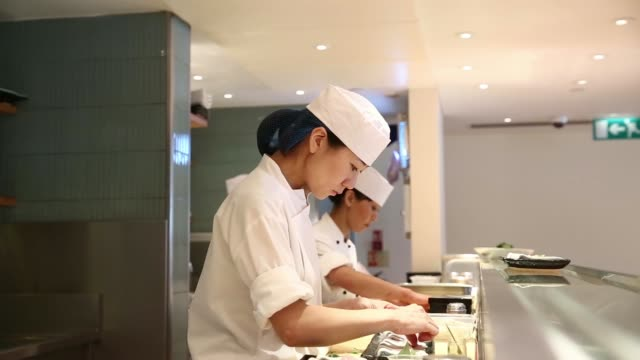 various shots sushi chefs work and prepare dishes in the kitchen at the nobu london luxury restaurant inside the metropolitan hotel in london uk on... - sushi stock videos and b-roll footage