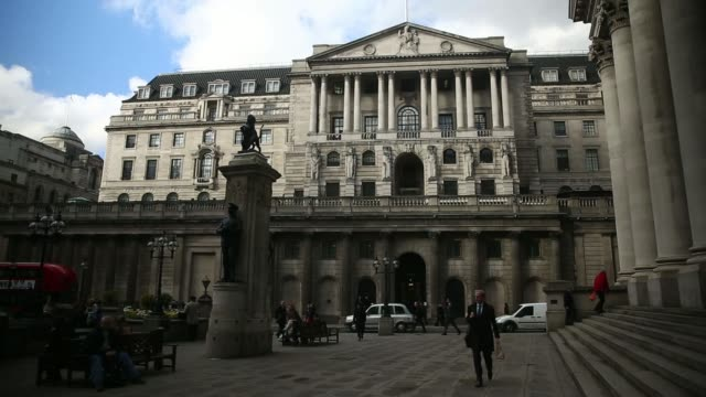 various shots the bank of england headquarters building stands with other office towers behind it in london uk on tuesday feb 4 various general views... - 金融関係施設点の映像素材/bロール