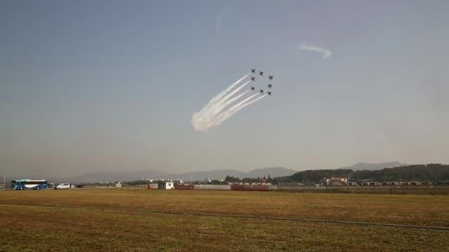 Various shots the South Korean Air Force Black Eagle aerobatics team performs maneuvers during the Cheongju International Airport Air Show on the...