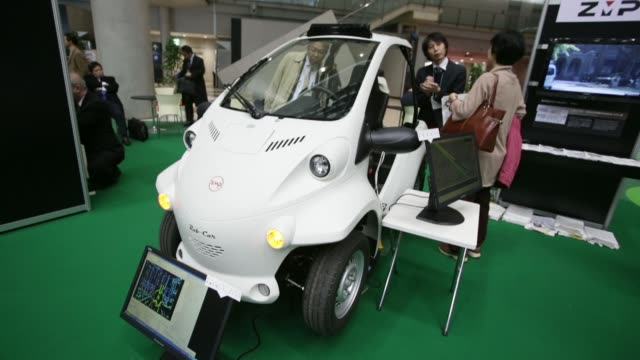 various shots visitors inspect a zmp inc robocar mv2 research and development platform vehicle based on toyota auto body co coms super compact... - compact car stock videos and b-roll footage