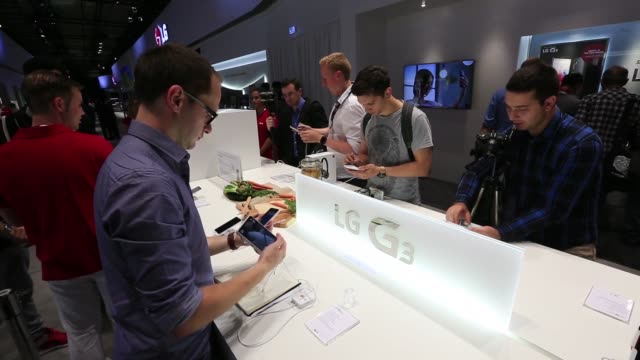 Various shots visitors look at LG Electronics Inc G3 smartphones on a media preview day ahead of the IFA 2014 Consumer Electronics Fair in Berlin...