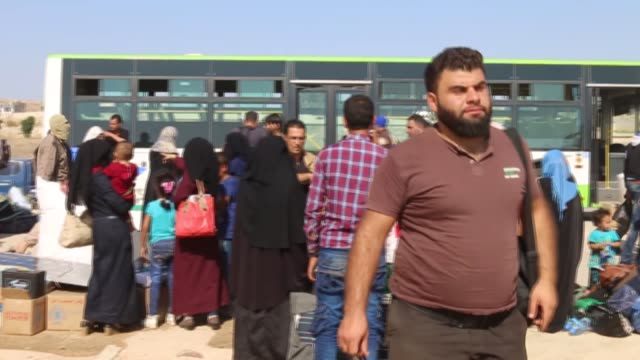 various shots while syrian civilians are seen after third convoy carrying opposition fighters and civilians set out from syria's southwestern daraa... - civilian stock videos & royalty-free footage