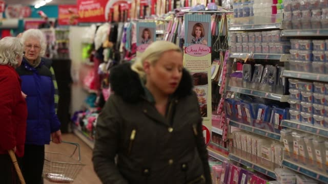 Various shots women customers browse goods in the homewares section of an a Poundland discount store operated by Poundland Group Plc in the Fulham...