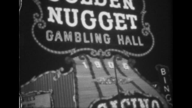 stockvideo's en b-roll-footage met various signs at las vegas street at night the mint fremont bingo hotel las vegas silver palace golden nugget gambling hall 1905 - bingo