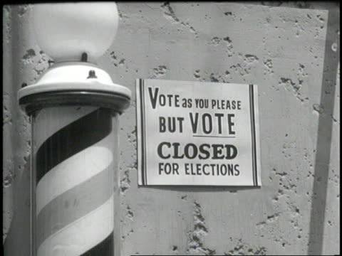 stockvideo's en b-roll-footage met various signs encourage citizens to vote on election day - stembus