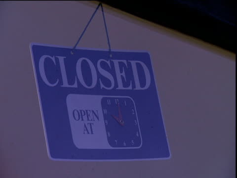 vídeos de stock, filmes e b-roll de various signs in seaside shop windows stating - sinal informativo