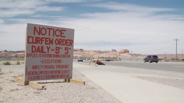 """various signs on navajo nation during covid-19 pandemic include some that state """"all residents stay home"""" fire rock casino and """"together we can beat... - indigenous north american culture stock videos & royalty-free footage"""