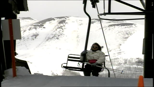 various skiers getting off ski lift in butte colorado - スキーウェア点の映像素材/bロール