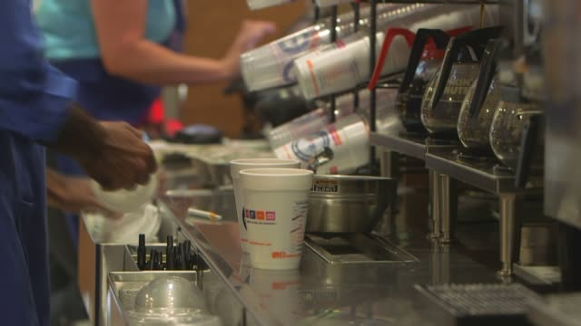 various slow motion shots of dunkin donuts employees making coffee in canton massachusetts on september 20 tight slow motion shots of an employee... - polystyrene stock videos & royalty-free footage