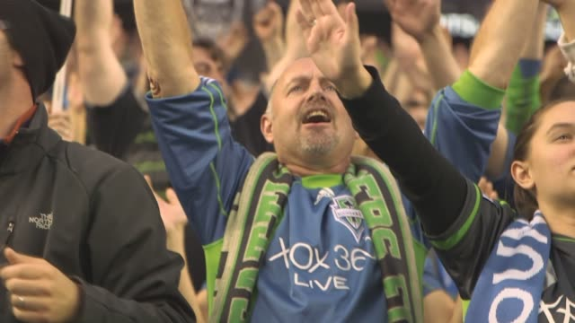 various slow motion shots of seattle sounders fc fans packed in centrurylink field in seattle washington on march 19 a medium wide shot of fans... - major league soccer stock videos and b-roll footage