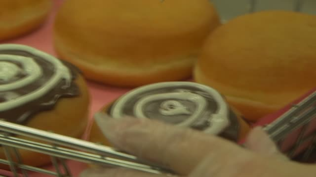 various slow motion shots of the doughnut making process at a dunkin donuts in canton ma on september 20 a tight slow motion shot of an employee... - squirting stock videos and b-roll footage