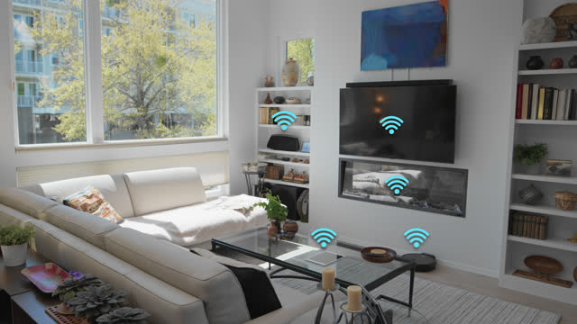 stockvideo's en b-roll-footage met various smart devices in the tidy living room of a smart home - audio available