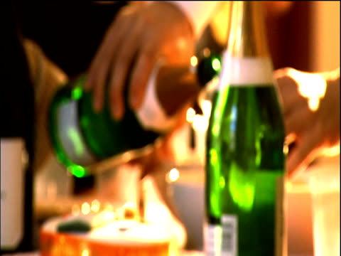 various soft focus shots of party table with champagne bowls of crisps and cake - 塩味スナック点の映像素材/bロール