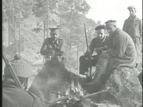 various soldiers around campfire in hills during ceasefire soldier standing guard ws soldiers walking along dirt road indiapakistani war of 1947 - waffenstillstand krieg stock-videos und b-roll-filmmaterial