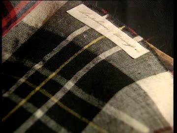 vídeos y material grabado en eventos de stock de various tartan fabrics in sample book are flicked through scotland - tartán