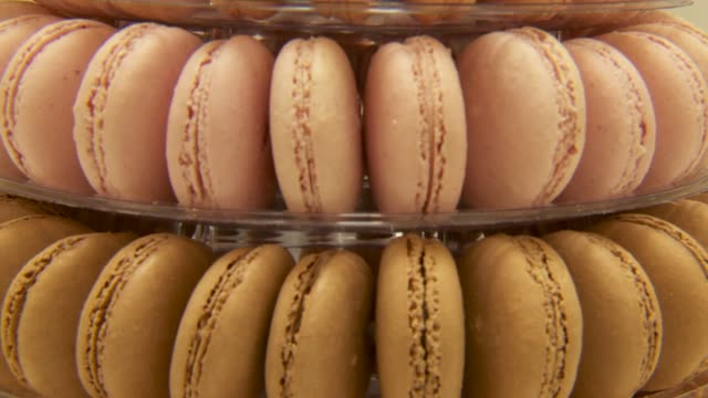 various tight shots of a stack of multi colored macaroons a tight tilt down shot of multi colored macaroons stacked on a tower a tight panning shot... - macaroon stock videos & royalty-free footage