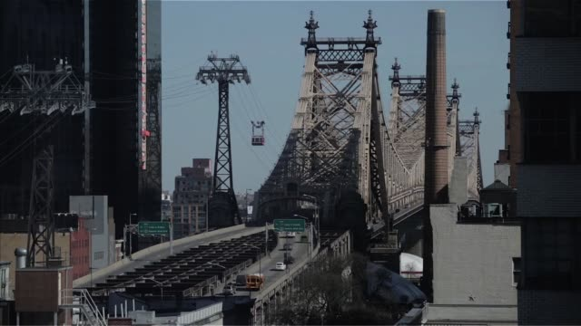 Various timelapse shots of the Queensboro Bridge in Midtown Manhattan New York City New York on March 24 A wide time lapse shot of traffic entering...