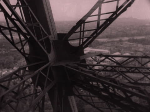 various tracking shots from inside an eiffel tower lift as it moves up the structure. 1952. - eiffel tower stock videos & royalty-free footage