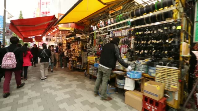 Various tracking shots past shops and people in the street in the Akihabara district in Tokyo Japan on Thursday Nov 14 Tracking shots through a...