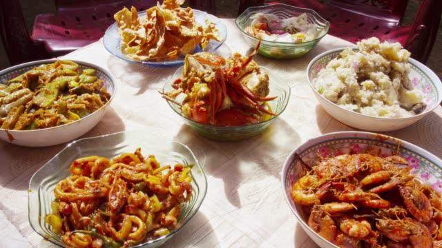 various traditional food on the table in cinnamon island, koggala, sri lanka - カレー料理点の映像素材/bロール