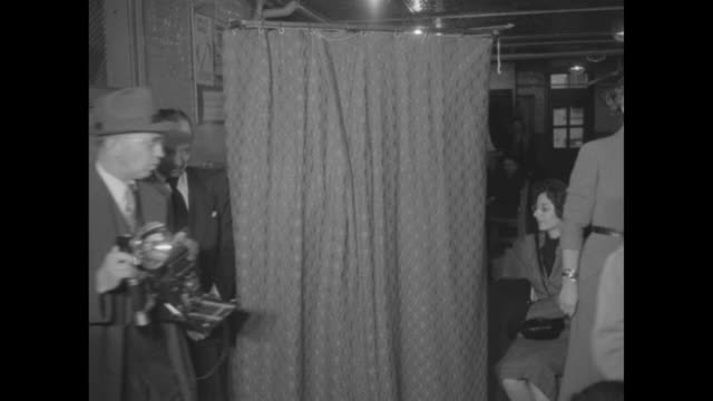 pan long line outside polling place at a school / interior election monitor stands by curtained voting booth // dwight eisenhower at voting booth in... - 1952 bildbanksvideor och videomaterial från bakom kulisserna