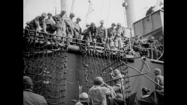 various us marines climbing down net on side of transport ship boarding landing crafts navy fleet just off shore bombing / vs united states marines... - iwo jima island stock videos & royalty-free footage