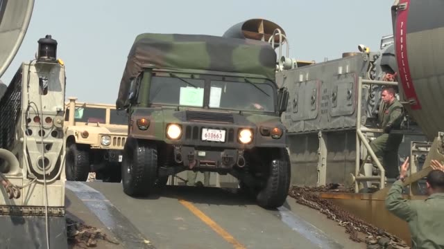 various vehicles arrive via landing craft air cushion in support of exercise ssang yong 14 at dogue beach pohang the republic of korea april 02 2014... - cushion stock videos and b-roll footage