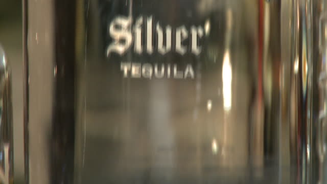 various views and angles of avion tequila on display - avion stock-videos und b-roll-filmmaterial