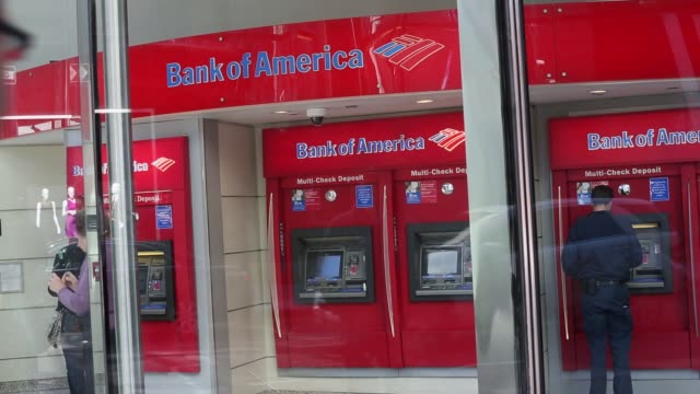 various views of a bank of america branch in manhattan / people using atm / various views of signage and logo / employees working / people passing by... - bank of america stock videos & royalty-free footage