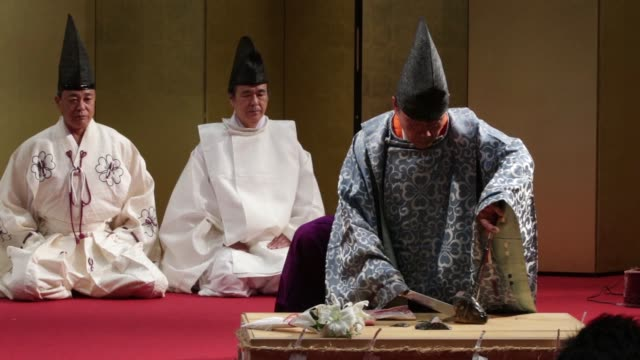 Various views of a traditional culinary knife ceremony demonstration performed on stage at the Monozukuri Takumi no Waza Expo 2016 in Tokyo Japan on...