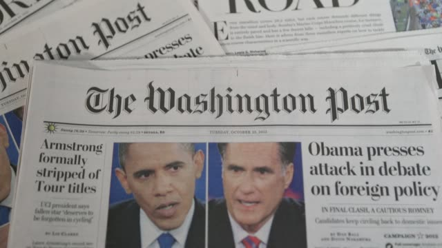 various views of a washington post newspaper with election headlines / obama and romney debate headlines washington post newspaper on october 23,... - foro video stock e b–roll