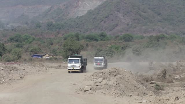 various views of debris trucks on a landfill site in navi mumbai maharashtra india on tuesday feb 2 2016 - e waste stock videos & royalty-free footage