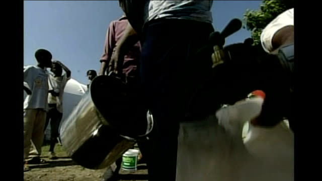 various views of displaced person camps with tents and other makeshift shelters close shot of containers being filled with water from standing pipe... - temporary stock videos & royalty-free footage