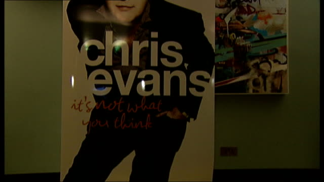vídeos de stock, filmes e b-roll de int various views of evans' being interviewed close shot of poster for autobiography evans interview sot on taking over wogan's show and how he is... - biografia