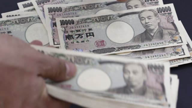 Various views of Japanese 10000 yen banknotes being counted at the Korea Exchange Bank headquarters in Seoul South Korea on Monday March 16 2015