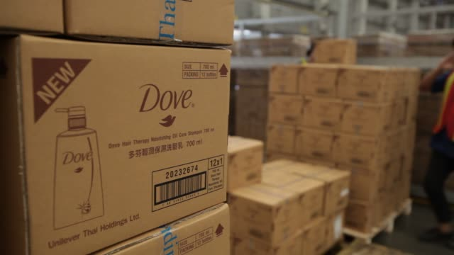 various views of male employees loading boxes of Unilever's Dove products for shipment Unilever Dove Shipment on October 16 2012 in Lat Krabang...