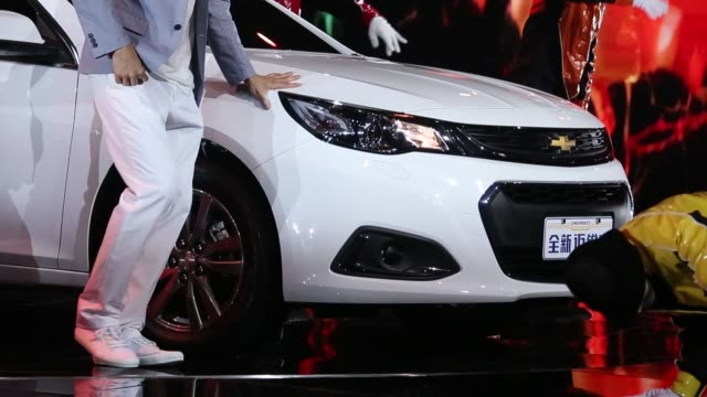 vidéos et rushes de various views of performers dancing in around the chevrolet malibu vehicle the buick verano vehicles produced by general motors co are driven on the... - chevrolet