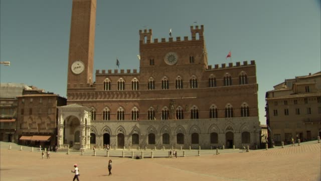 various views of the famous piazza del campo / principal public space of the historic center of siena italy / shows the town center building palazzo... - palazzo pubblico stock videos and b-roll footage