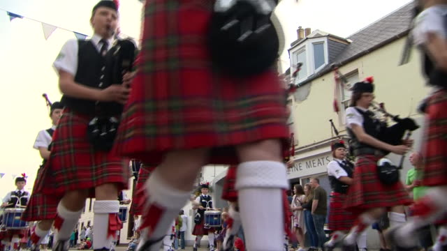 various views of the innerleithen fancy dress parade - kilt stock videos & royalty-free footage