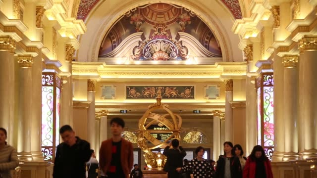 various views of visitors and the lobby of the venetian macao resort and casino, operated by sands china ltd., a unit of las vegas sands corp - macao stock videos & royalty-free footage