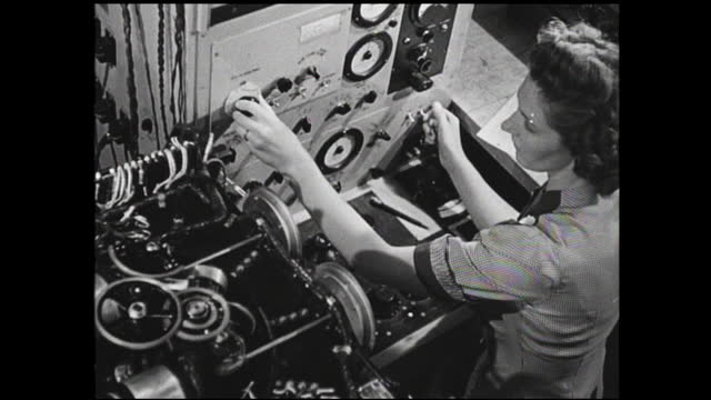 various views of woman adjusting knobs and dials; still image of women workers working on the assembly line inside factory - 1940 1949 stock-videos und b-roll-filmmaterial