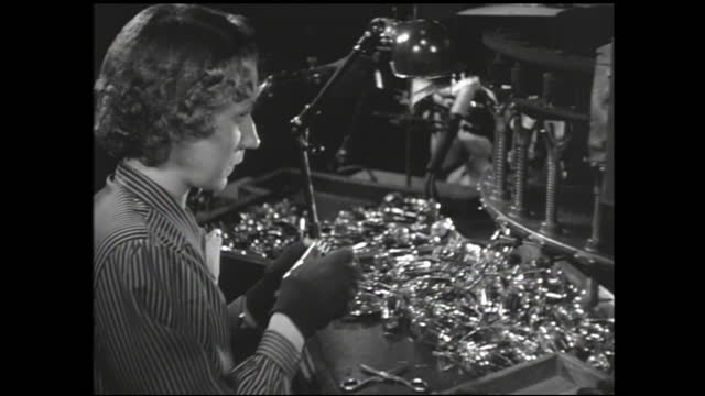 various views of women workers working on the assembly line making complex parts; machinery spinning vacuum tubes and sealing them with heat; woman... - 1940 1949 stock videos & royalty-free footage