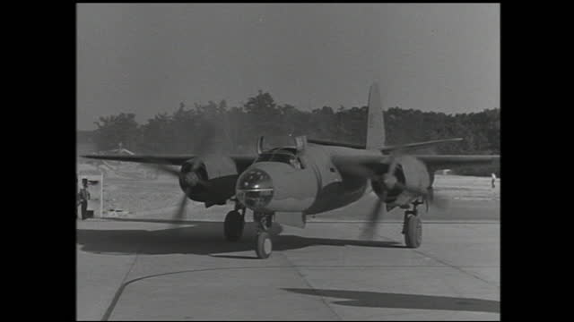 various views of workers assembling small components on the assembly line; pilots getting ready in the cockpit and plane taking off - 1940 1949 video stock e b–roll